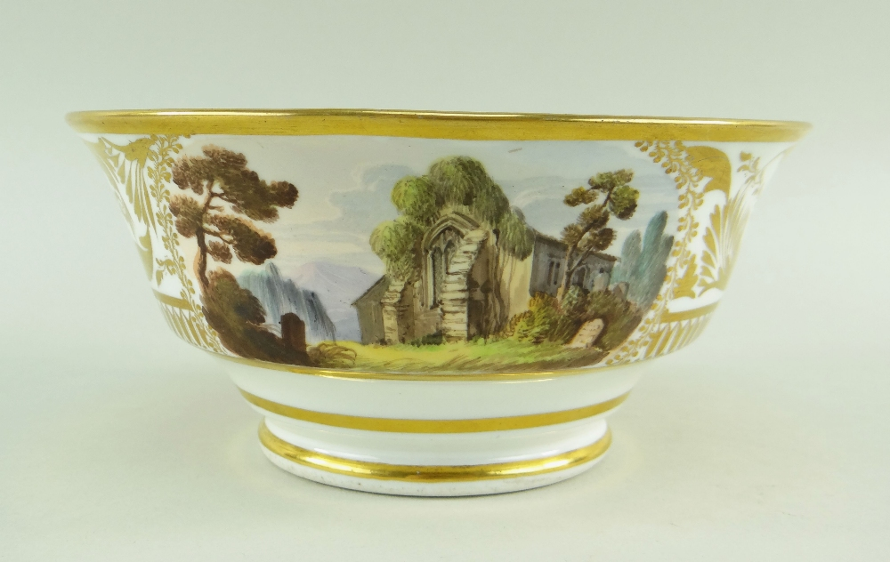 A SWANSEA PORCELAIN LANDSCAPE DECORATED TEA BOWL of footed form with flared body, London decorated - Image 3 of 3