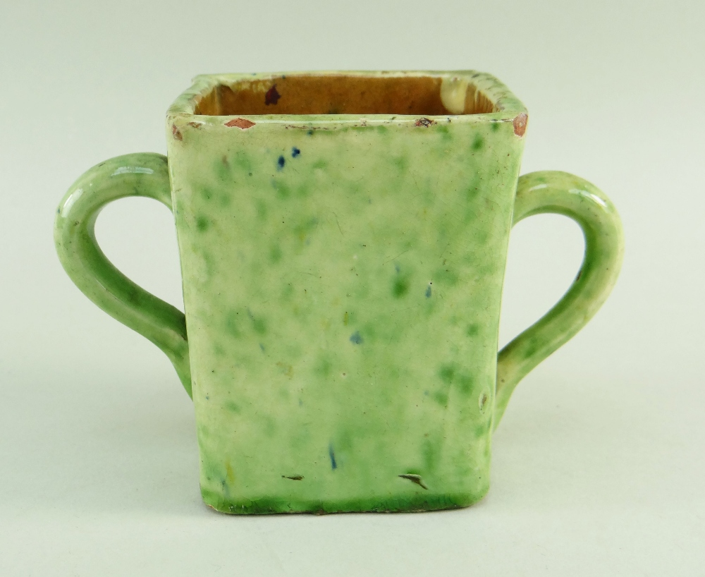 A EWENNY SLIPWARE POTTERY TWIN HANDLED MEAD CUP square based, mottled lime green glaze, with - Image 2 of 3