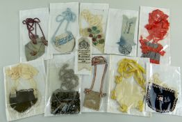 COLLECTION OF EARLY 20TH CENTURY EISTEDDFOD RELATED ITEMS comprising nine purses of varying design