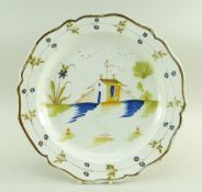 A SWANSEA POTTERY 1802-1810 PEARLWARE CHARGER DISH of lobed form, the interior painted in deep blue,