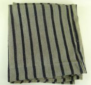 A TWO SECTION JOINED HEAVY WEIGHT ANTIQUE WELSH BLANKET having narrow dark blue flecked stripes