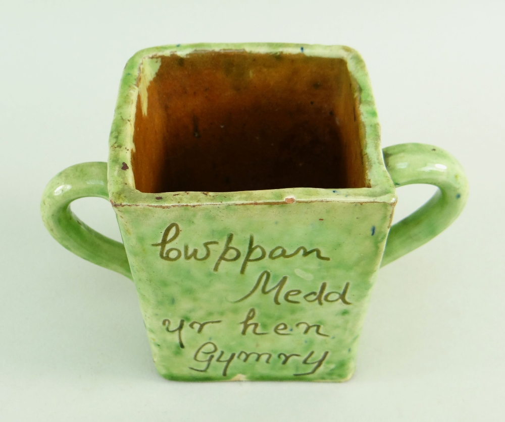 A EWENNY SLIPWARE POTTERY TWIN HANDLED MEAD CUP square based, mottled lime green glaze, with - Image 3 of 3