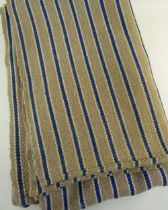 A TWO SECTION JOINED HEAVY WEIGHT ANTIQUE WELSH BLANKET having narrow blue stripes with off-white
