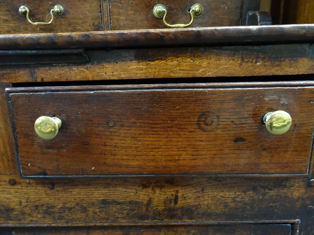 A SMALL CHARACTERFUL OAK NORTH WALES CUPBOARD-BASE WELSH DRESSER circa 1770-1800 having a base of - Image 25 of 26