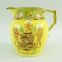 A SWANSEA EARTHENWARE CANARY YELLOW POLITICAL JUG enamel decorated with motto, crest and coat-of-