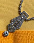ART DECO DIAMOND ENCRUSTED PENDANT ON CHAIN, having diamond drop (1.0ct approx.) below the pierced