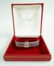 OMEGA 9CT WHITE GOLD LADIES WRISTWATCH, the inside back cover marked 'Omega Watch Co' and numbered