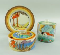 THREE CLARICE CLIFF ITEMS comprising 'Forest Glen' preserve jar & cover, 7.5cms high; 'Coral Firs'