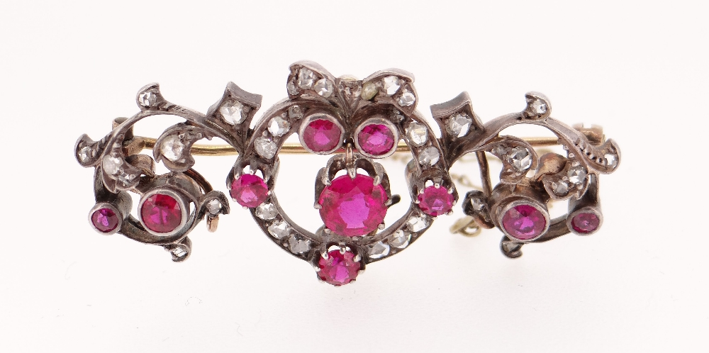 YELLOW & WHITE METAL SET DIAMOND & RUBY BAR BROOCH of naturalistic bow, scroll and leaf design, 11. - Image 2 of 2