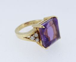 18CT GOLD AMETHYST & DIAMOND DRESS RING, the large square cut amethyst (12 x 12mms) flanked by a
