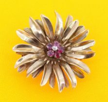 YELLOW METAL DIAMOND & RUBY FLORAL BROOCH, the small central diamond surrounded by five rubies, 16.