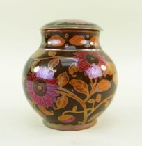 ZSOLNAY PECS FLAMBE LUSTRE JAR & COVER, c. 1924-1970, painted with sunflowers in puce and orange