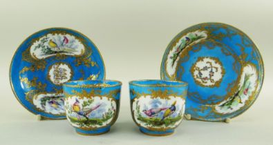 TWO SEVRES-STYLE PORCELAIN BLEU CELESTE TEA CUPS AND SAUCERS, 19th Century or later, decorated