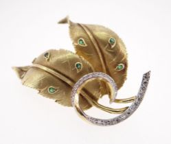 14CT GOLD EMERALD & DIAMOND LEAF BROOCH, 5.5cms wide, 18.6gms, in Jeffries of Newport jewellery