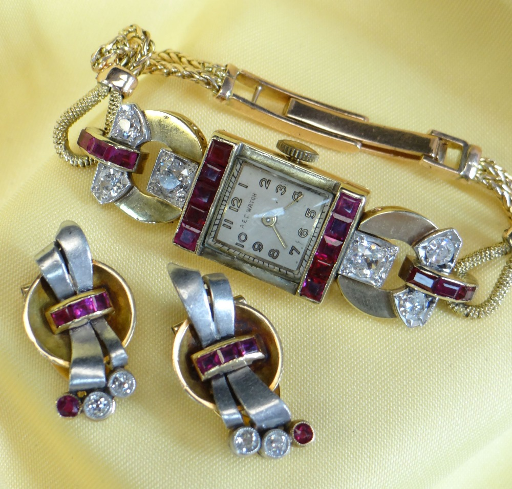 YELLOW METAL DIAMOND & RUBY SET COCKTAIL WATCH, the dial marked 'A E C Watch', set with a border