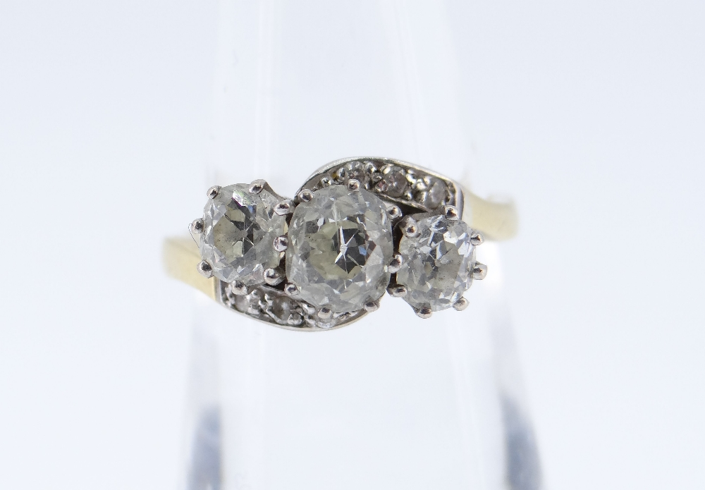 18CT GOLD THREE STONE DIAMOND RING, the three primary stones (totalling 1.0cts approximately) on a - Image 2 of 2
