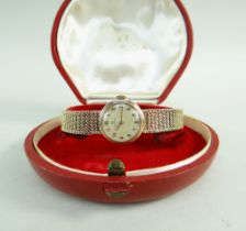 OMEGA 9CT GOLD LADIES WRISTWATCH having integrated 9ct gold strap, the inner back cover marked '