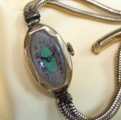 18CT GOLD LADIES WRISTWATCH, oval green guilloche enamel art deco dial engraved to reverse 'Daphne C