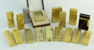 COLLECTION OF CARTIER, DUNHILL & DUPONT CIGARETTE LIGHTERS, mostly gold plated with various textured