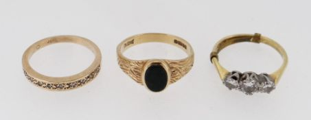 THREE GOLD RINGS comprising 18ct gold three stone diamond ring, gold diamond chip half eternity ring
