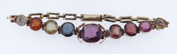 YELLOW METAL MULTI-GEM BRACELET featuring nine graduated gem stones, 17.5cms long, 6.9gms