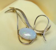 9CT GOLD OPAL BAR BROOCH of flowing loop design, the oval opal measuring 15 x 9mms, 3.9gms, in