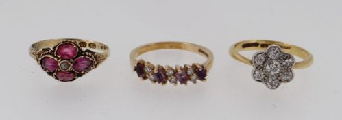 THREE GOLD RINGS comprising 18ct gold & platinum diamond cluster ring, 12ct gold ruby ring and a 9ct