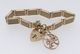 9CT GOLD GATE BRACELET, with 9ct gold Welsh dragon charm, yellow metal Celtic Knot charm, 30.6gms
