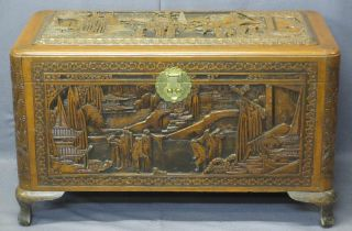 CHINESE CAMPHORWOOD LIDDED CHEST - deep carved pagodas and people in garden settings, original brass