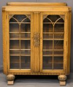 GOOD HONEY OAK ART DECO BOOKCASE - railback with central reeded and carved panel and flanking glazed