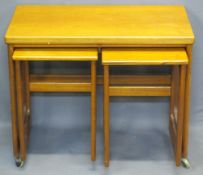A H McINTOSH & CO SCOTLAND MID-CENTURY TEAK NEST OF THREE TABLES - the largest with swivel