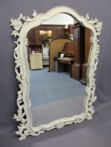 REPRODUCTION PAINT WASHED ROCOCO STYLE GILT FRAMED WALL MIRROR - 117cms H, 90cms max W
