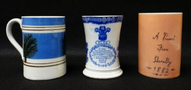 THREE LLANELLY MUGS including a mocha ware pint measure, decorated with sponged trees to coloured