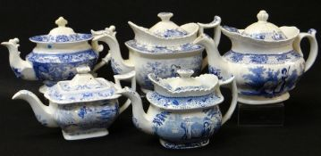FIVE ANTIQUE WELSH POTTERY TEAPOTS, each in various blue and white transfer patterns including '