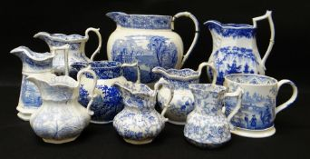 GROUP OF TEN SWANSEA POTTERY BLUE & WHITE TRANSFER JUGS including large 'Milan' transfer jug,