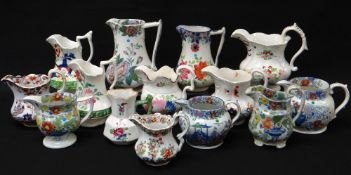 COLLECTION OF FOURTEEN COLOURFUL WELSH POTTERY JUGS painted and transfer decorated, Llanelly and
