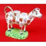 SWANSEA PEARLWARE COW CREAMER typically decorated with lilac and iron red lustre, standing on a '