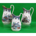 GRADUATED TRIO OF SWANSEA POTTERY JUGS IN THE 'BIRDS' TRANSFER with birds in natural surroundings,