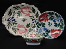 THREE LLANELLY POTTERY ITEMS IN THE PERSIAN ROSE PATTERN comprising large tureen stand, 41cms,