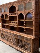 LARGE CONTINENTAL STYLE DISPLAY/STORAGE UNIT having leaded glazed upper doors, central arched