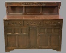 PRIORY OAK STYLE BUFFET SIDEBOARD having three frieze drawers and twin lower cupboard doors, all