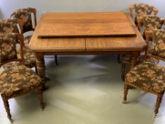 CIRCA 1900 OAK WIND-OUT DINING TABLE with two additional leaves, the top with cut-off corners, on