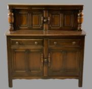 ERCOL OAK BUFFET SIDEBOARD with twin upper cupboard doors and bulbous top support detail over a base