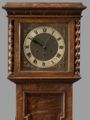 VINTAGE OAK GRANDMOTHER CLOCK having pierced gilt spandrels and silvered chapter ring to the dial,