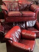 THREE PIECE LOUNGE SUITE in red leather effect upholstery, comprising three seater couch, 82cms H,