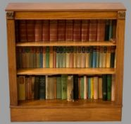 REPRODUCTION MAHOGANY BOOKCASE and books (as displayed), 92.5cms H, 91cms W, 29cms D