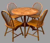 MODERN PINE CIRCULAR PEDESTAL TABLE, 73cms H, 91cms diameter and four light wood spindleback