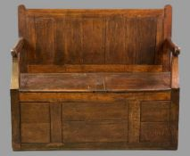VINTAGE OAK DOUBLE BOX SEAT BENCH, joined oak construction with panelled back and open arms,