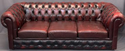 RED LEATHER UPHOLSTERED CHESTERFIELD SETTEE - 3 seater, 71cms H, 210cms W, 54cms seat D
