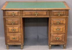 NEATLY PROPORTIONED TWIN PEDESTAL DESK - having inset green leatherette surface over three frieze